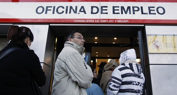 Unemployed workers wait outside a government job centre in Madrid